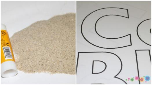 raidės+smėlis
